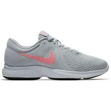 82695b210e2b Nike Women s Revolution 4 Running Shoe Platinum sunset Pulse-wolf Grey 7 US  2e