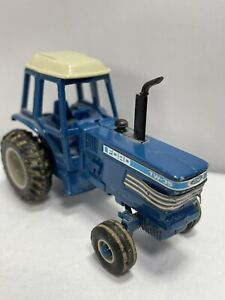 Vintage Ertl Ford TW-35 Tractor Blue White 1:64 Scale Diecast Dirt On The Tires
