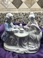 Vintage Seated Couple Having Tea  Painted Iridescent porcelain figurine -Japan