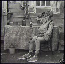 Glass Magic Lantern Slide MAN WITH GIANT SHOES DRINKING C1890 PHOTO