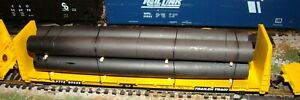 HO scale Roundhouse TTX 60' bulkhead flatcar #90509 with pipe load train