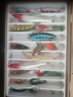 15 fishing spinners and one lure in a box