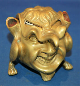 A 19th century brass antique devil, satyr, grotesque, imp inkwell, pen holder