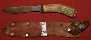 Vintage hand made hunting knife with bone handle and leather sheath