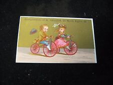 1800's Heller North 8th St. Boy & Girl Bicycle Riding Victorian Trade Card