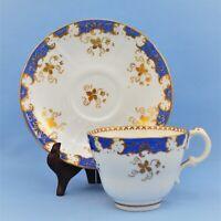 VINTAGE ANTIQUE PORCELAIN CUP AND SAUCER SET WHITE BLUE GOLD