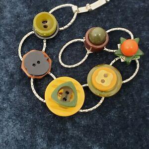 Bakelite button bracelet on antique brass base.  FuN #3