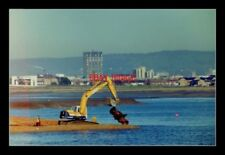 PHOTO  CARDIFF  PIPE LAYING SECTIONS OF PIPE USED FOR MOVING THE SAND ABOUT ARE