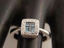 Princess Quad Radiated Blue Illusion Diamond Halo Engagement Ring 18k E/VS2