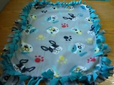 Handmade fleece tie blanket of puppy faces on blue for a small pet