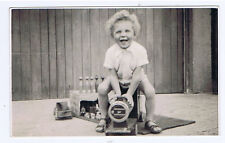 Young Boy Sitting On Toy Train - Vintage Photograph c1950's