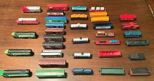 Lot of 35 HO Train Locomotives, Tankers, Freight, Box, Flatbed Caboose.