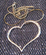 Silver Tone chic style necklace with a heart design set with white stones