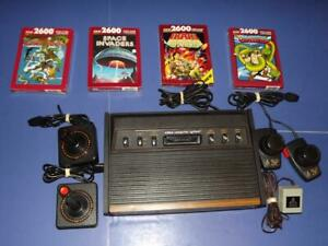 ATARI 2600 HEAVY SIXER SUNNYVALE CA. WITH 4 BRAND NEW RED LABEL/BOX GAMES!!!