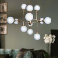 lampadario 12 luci moderno design Copernico in OTTONE con vetro soffiato bianco