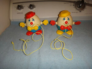 FISHER PRICE 1971 HUMPTY DUMPTY PLASTIC TOYS LOT OF 2 YELLOW/RED PULL TOYS