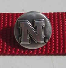 Lot of 10 Nebraska Huskers conchos.  Unique way to personalize your items!