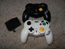 Two Nintendo GameCube Mad Catz Wireless Controllers 5686 Black & White