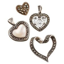 FOUR (4) VINTAGE STERLING SILVER MARCASITE DECORATED HEART SHAPE PENDANTS