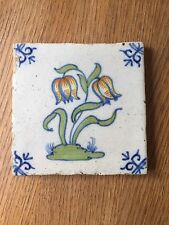 pretty early Delft tile with flowers, 17th or 18th century