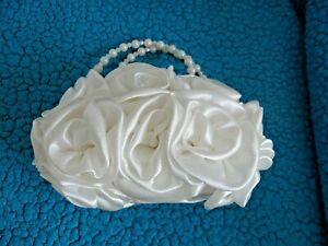 WEDDING TIARA BY WARREN YORK INTERNATIONAL,ALSO CREAM ROSE HAND BAG NEVER USED