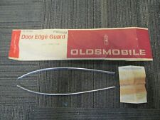 1967 Oldsmobile Delta 88 Custom NOS GM 2 Door Edge Guard Set # 982829