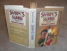 Bernard Cornwell - Sharpe's Sword - HB/DJ 1st ed 1983 - Scarce but worn