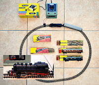 Locomotive Trix Express 2203 + 3 wagons + alim 12-14/220V + circuit complet