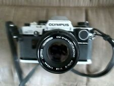 Olympus OM-10 35mm SLR Film Camera with 50 mm lens and 4 lens filters