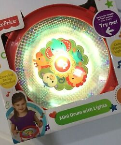BRAND NEW! FISHER PRICE MINI DRUM WITH COLOR FLASHING LIGHTS AND DRUMSTICKS TOY