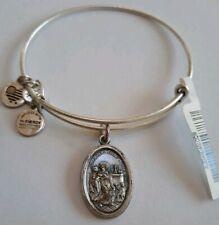 DiamondJewelryNY Eye Hook Bangle Bracelet with a St Katharine Drexel Charm.