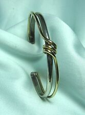 "SCAPA 10K Gold & Sterling Bracelet 17.1 grams  circumference: 6"" plus 1"""