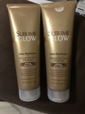 2 L'OREAL SUBLIME GLOW DAILY MOISTURIZER MED SKIN TONES 8oz EA