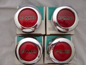 Lot of four NOS Pontiac Rally Wheel center caps, red PMD emblems