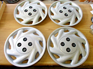 Genuine 1996 to 1999 Saturn S bolt on 14 inch hubcaps wheel covers set