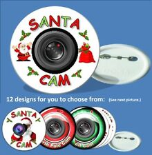 One Christmas Santa Cam Badge (58mm) 12 designs to pick from.(Elf & Nth Pole)