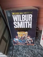 The Leopard Hunts in Darkness, by Wilbur Smith, a Pann books book