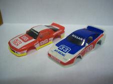 Afx/Tomy Nissan (2) Nos Unused bodies Chevy Camaro & Nissan 300Z~Aurora~Ho~Wow