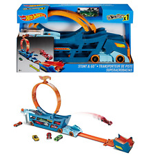 Hot Wheels Stunt and Go Truck Includes one Hot Wheels Car