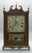 Eli Terry Pillar And Scroll Clock Mahogany veneer case with three br. Lot 1285