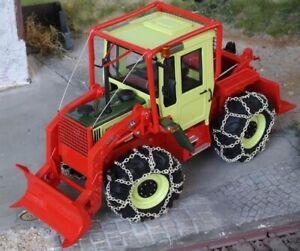 MO65606 - Tracteur en résine avec équipement forestier et chaînes - MB Trac 1100