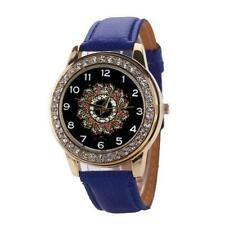 Women`s Gold Quartz Crystal Black Patterned Faced with Blue Band Wrist Watch.