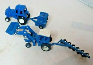 LOT OF 4 ERTL 1/64 FORD TW35 TRACTOR W/ FRONT LOADER 6 BOTTOM PLOW BALLER