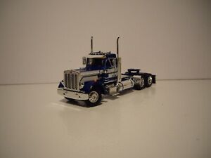 DCP FIRST GEAR 1/64 BLUE AND WHITE PETE 359 DAY CAB