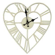 RETRO SHABBY CHIC CREAM / WHITE METAL HEART SHAPED WALL CLOCK. NEW AND BOXED.