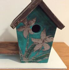 Painted distressed wooden birdhouse with flower design turquoise and brown