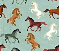 GREEN FABRIC WITH A DESIGN OF WILD HORSES - 100% COTTON FQ'S