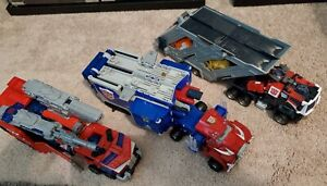 Transformers Leader Class Energon, Armada and Cybertron Optimus Prime Lot of 3.