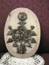 OVAL CARVED WALL HANGING WITH CARVED POLISHED RAISED FLORAL PATTERN