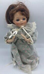 Porcelain Doll with Brunette Hair and Blue Eyes 12 inch HJ&G mark
